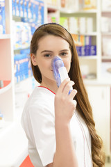 Pharmacist holding an aerosol mask