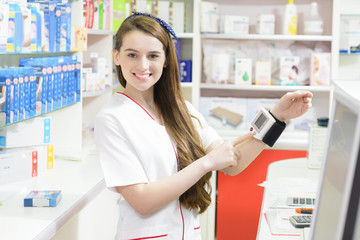 Pharmacist showing a tonometer