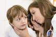 Otolaryngologist examining a kid ear
