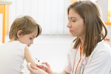 Boy being injected at clinic