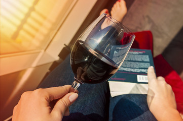 Relaxing with wine and book - POV photo