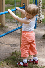Active little child climbing on a ladder