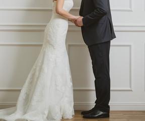 Elegant bride and groom posing together