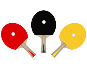 three table tennis rackets