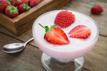 Yogurt with strawberry in glass
