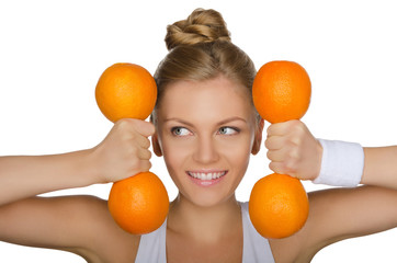 young girl with weights of oranges looking away