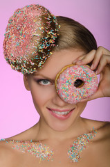 young woman, donut on head and front of eye