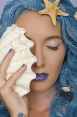 woman with blue hair, shells and closed eyes