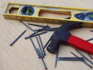 Hammer, nails, measure on wood