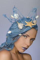 young woman with blue hair, crown and shells