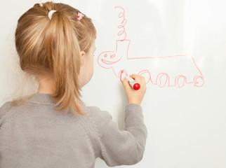 Girl drawing on a whiteboard