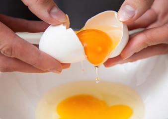 Female hands holding cracked egg