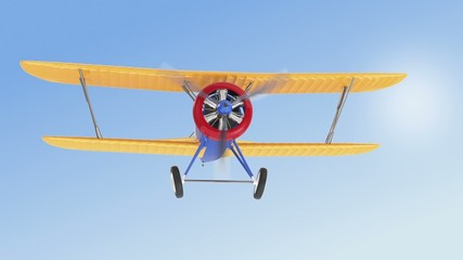 Yellow biplane flying in the sky