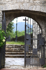 monastery gate, a narrow door the lattice