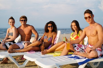 Group of multi ethnic friends relaxing on a beach