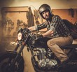Rider and his vintage style cafe-racer motorcycle