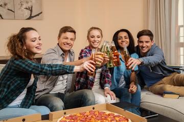 Friends celebrating in home interior