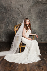 Photo of a beautiful smiling bride in luxurious wedding dress