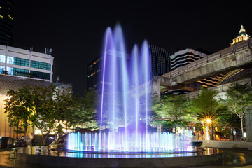 Colorful and lit fountain in downtown of Bangkok at night