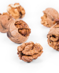 Heap of cracked walnuts.
