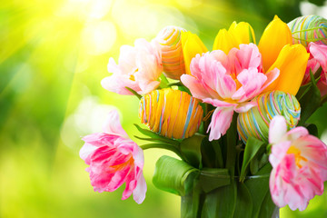 Easter holiday flowers bunch with colourful eggs