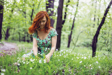 Girl sitting in the flower field