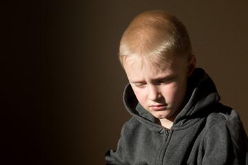 Sad upset worried unhappy little child (boy)