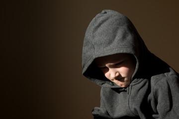 Sad upset tired worried little child (boy)