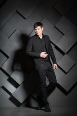 Handsome elegant man in black suit. Success