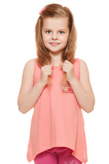 Little cute girl in a pink shirt holds hands hair, isolated