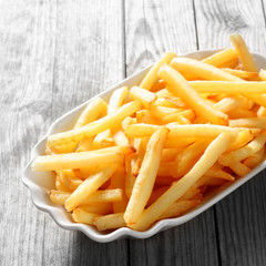 Cooked French Fries on White Plate on the Table