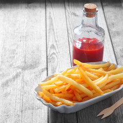 Fries on Plate and Sauce in Glass Jar on the Table