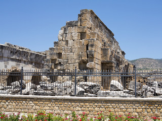 Ruins of the ancient temple in Hierapolis and blue sky