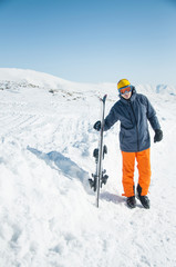 Skier sportsman at winter ski resort