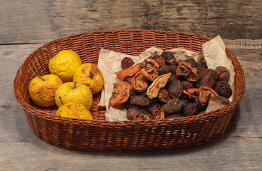 a handful of dried fruit in a wicker basket