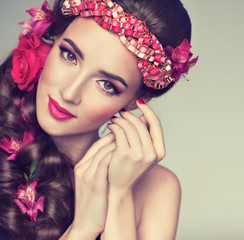 Spring model with flowers in her hair and fashion makeup