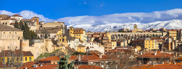 panoramic view of Segovia with aqueduct and mountains, Spain