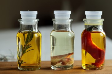 olive oil with pepper, lavender and garlic in glass bottles
