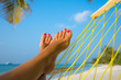 woman feet in hammock on the beach - 79030721