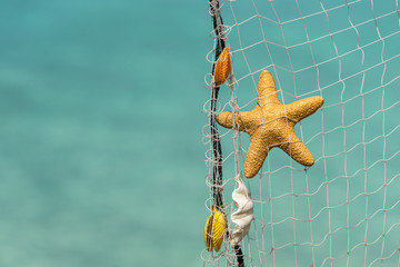 fishing net on a tropical beach background