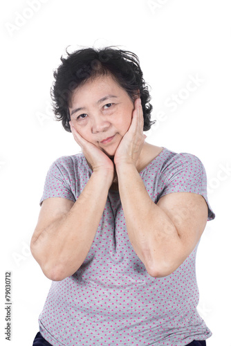 canvas print picture Asian senior female having a toothache holding his face with her
