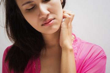 Woman scraching her neck
