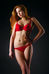 Young sexy woman in red lingerie.