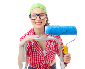 Smiling woman with paintroller ready for renovating