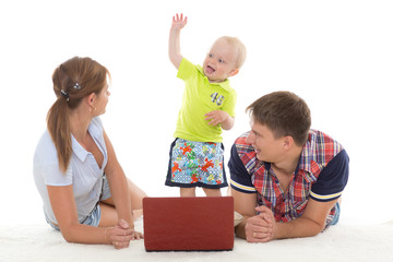 Happy family with notebook.