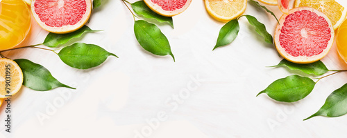 Citrus fruits slices with green leaves, banner