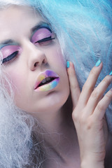 young woman with bright make up and creative hair