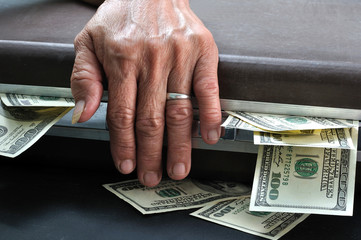 wrinkle senior hand touch suitcase full of dollar cash