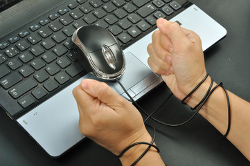 woman hand hold mouse and were bond with computer mouse, interne