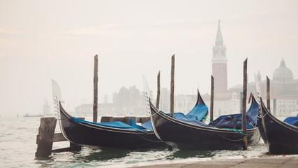 Venetian gondolas tied near the pier on San Marco square